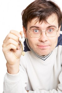 Man Holding Keys To The Business